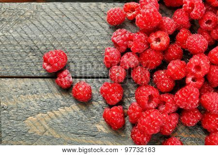 Sweet raspberries on wooden  background