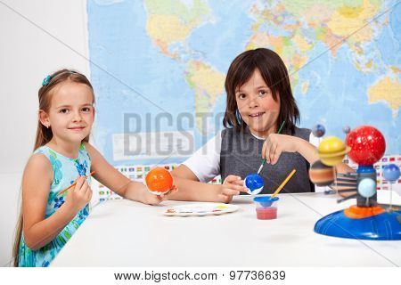 Kids in science and arts class -focus on girl face