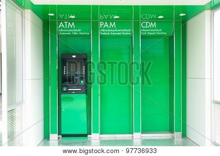 Black Automatic Teller Machine On Reflex Light Green Slot Plate