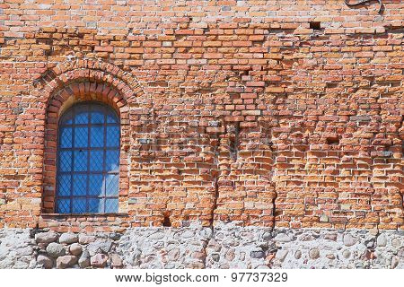 Exterior of the Trakai castle old brick wall with a window in Trakai, Lithuania.