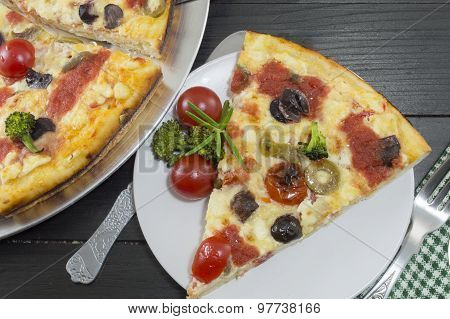 Vegetarian Pizza Slice Served With Cherry Tomato And Broccoli