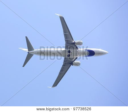 Large Passenger Plane Flying High In The Sky