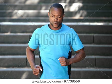 African American Man Running Down Stairs