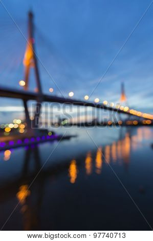 Abstract blurred bokeh lights background of suspension bridge