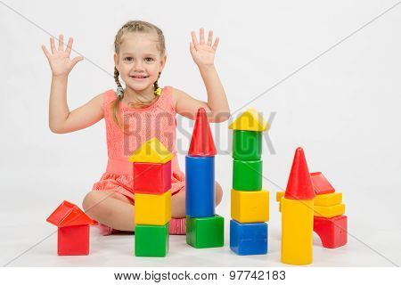 Girl Happily Raised His Hands, Playing With Blocks