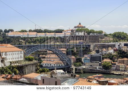 View Of Old Downtown And Famous Dom Luiz Bridge, Porto Cityscape, On A Summer Day