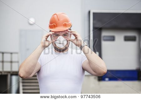 Builder Male Worker In Protective Mask And Glasses In The Helmet