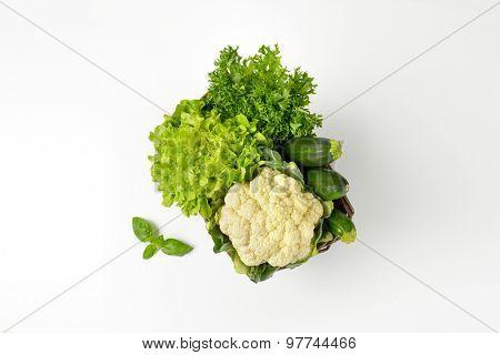 basket of fresh vegetables on white background