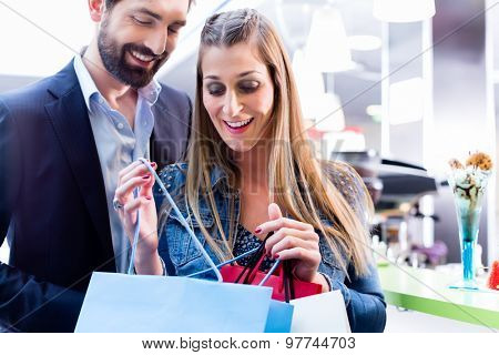 Woman and man shopping in mall