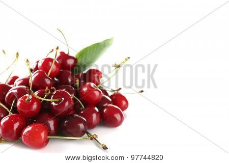 Pile of fresh cherries isolated on white