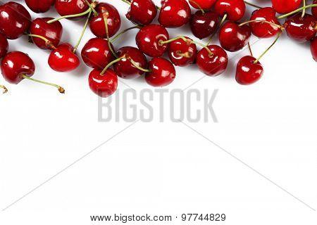 Frame of fresh cherries isolated on white