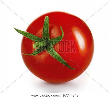 Single cherry tomato isolated on white