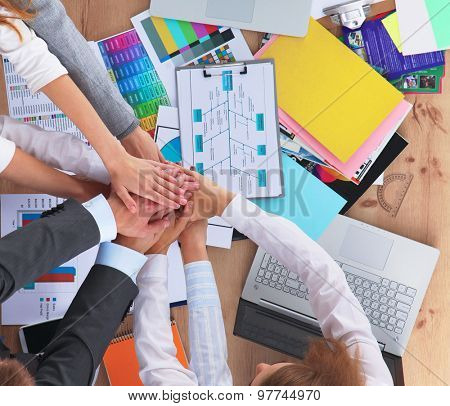 Business team with hands together - teamwork concepts.