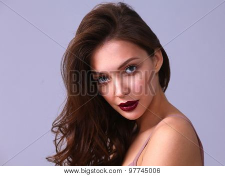 Portrait of beautiful woman , isolated on gray background.