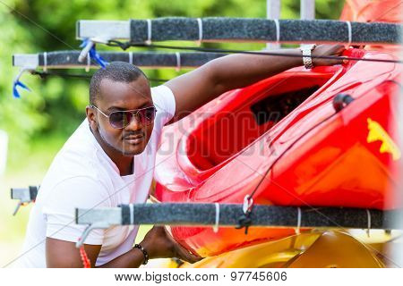 African man unloading boat from trailer