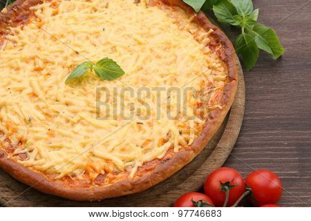Cheese pizza with cherry tomatoes on table close up