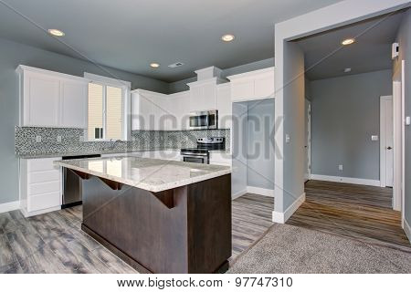 Unique Kitchen With Gray Hardwood Floor.