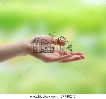 Female hand with drawings on nature background
