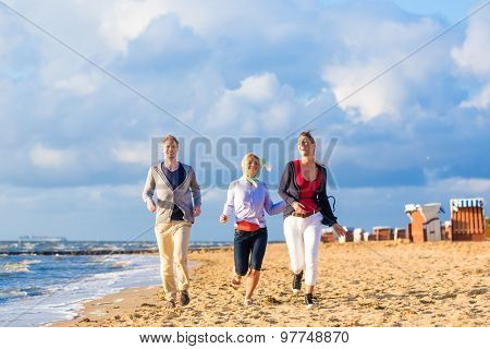 Friends enjoying sunset at German north sea beach