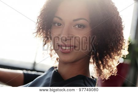 Office, lifestyle. Woman with African-American hairstyle