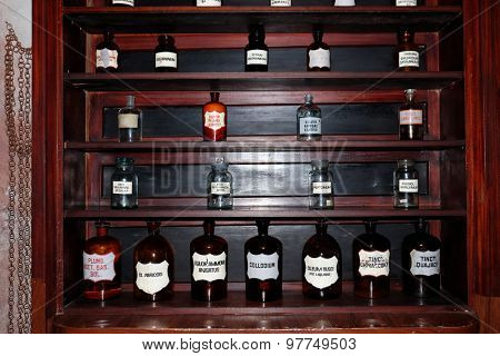 Chemicals and laboratory utensils on shelf
