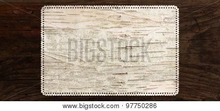 birch bark texture background with perforated tag edge