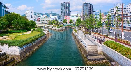 Downtown of Nagasaki city with city quay and canal river. Japan