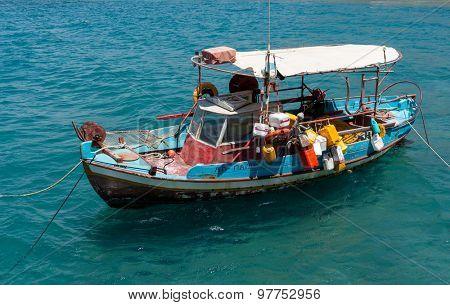 Fishing boat anchored in Matala bay, Crete, Greece