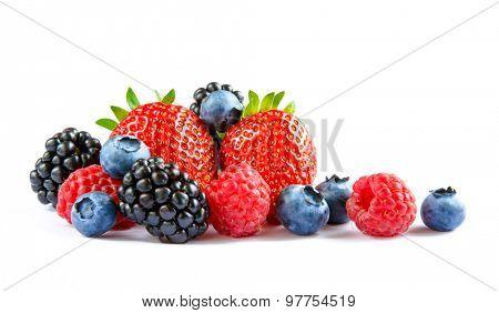 Big Pile of Fresh Berries on the White Background. Ripe Sweet Strawberry, Raspberry, Blueberry, Blackberry