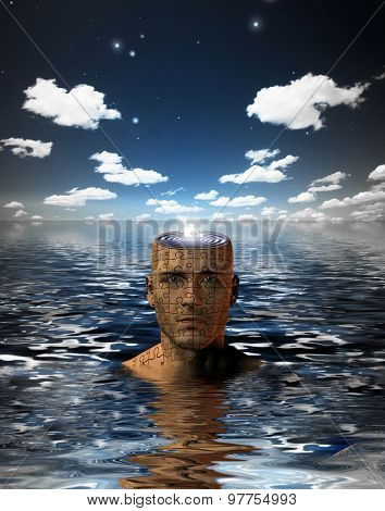 Man immersed in water with glowing puzzle piece in opened mind