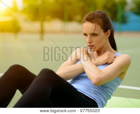 Young Athletic Woman Practice Morning Workout Exercises Outdoor. Fitness and Sport Lifestyle Concept