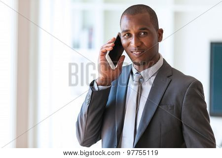 Portrait Of A Young African American Business Man Using A Mobile Phone - Black People