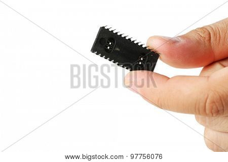 Male fingers holding microchip isolated on white
