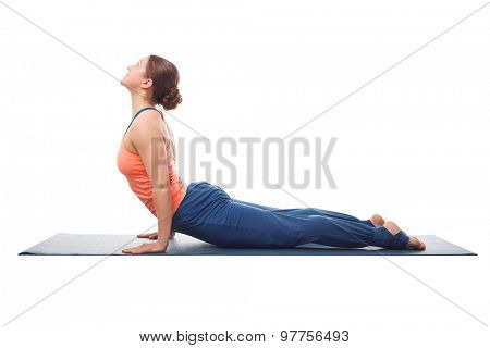 Beautiful sporty fit yogini woman practices yoga asana urdhva mukha svanasana - upward facing dog pose isolated on white