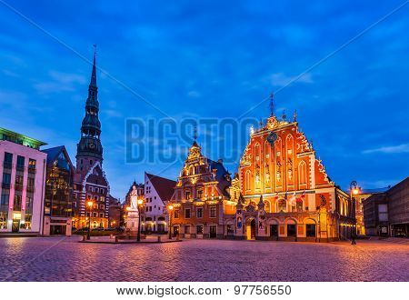 Riga Town Hall Square, House of the Blackheads, St. Roland Statue and St. Peter's Church illuminated in the twilight, Riga, Latvia
