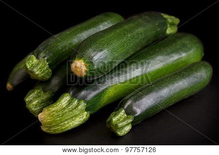 Whole green courgettes.