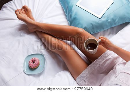 Woman having breakfast in the bed