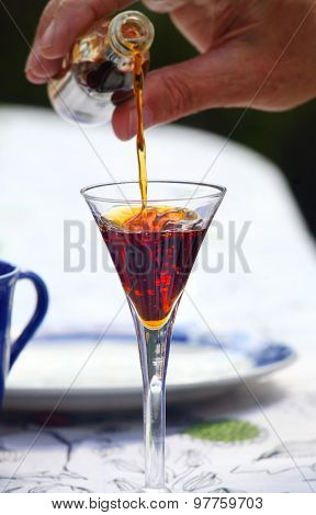 Liqueur being poured into glass