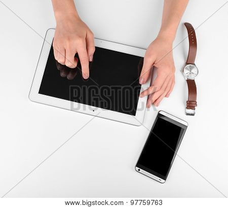Female hand using digital tablet isolated on white
