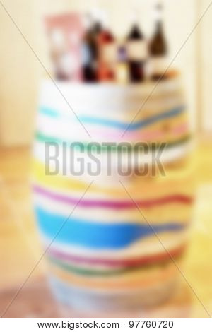 colorful wood barrel with a wine bottles on top