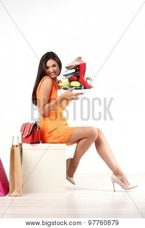 Beautiful young woman with shoes  isolated on white