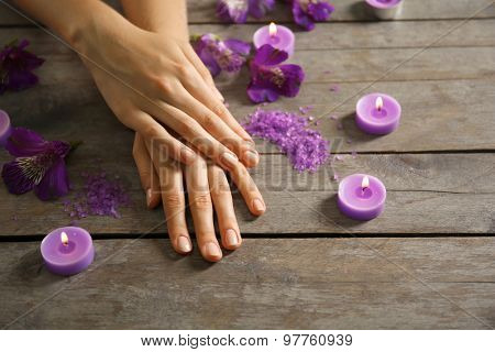 Female hands at spa manicure procedure