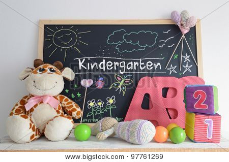 Blackboard in a kindergarten classroom and some baby stuff.