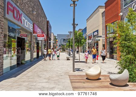 ASHDOD, ISRAEL - JULY 22, 2015: People among shops and boutiques in opened mall - owned by BIG Shopping Centers Ltd., founded in 1994 and operates in four countries - Israel, USA, India and Serbia.