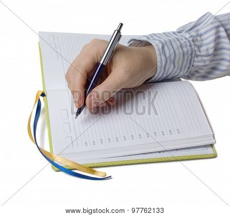 Man's Hand With A Pen And Notebook. Isolated On White Background