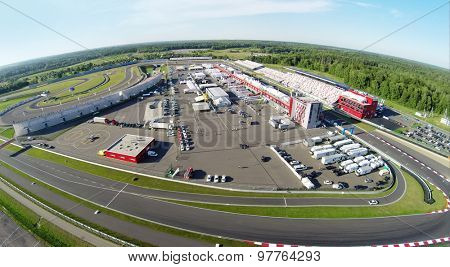 RUSSIA, MOSCOW - JUL 12, 2014: Trucks and cars parked on stadium Moscow Raceway. Aerial view (Photo with noise from action camera)