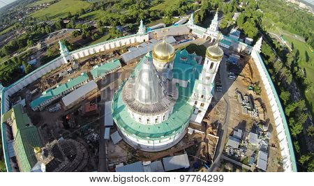 RUSSIA, MOSCOW -?? JUL 12, 2014: Construction site of New-Jerusalem Monastery with Christ Resurrection Cathedral at summer sunny day. Aerial view (Photo with noise from action camera)