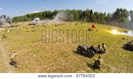 RUSSIA, NELIDOVO - JUL 12, 2014: German troops fight in trenches with Red army during reconstruction Battlefield at Second World War. Aerial view. (Photo with noise from action camera)