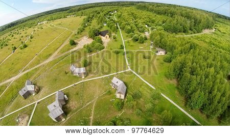 RUSSIA, NICOLA-LENIVETS - JUL 5, 2014: Summer houses in Wonderland park during 9th International Festival of landscape objects Archstoyanie at day. Aerial view. (Photo with noise from action camera)