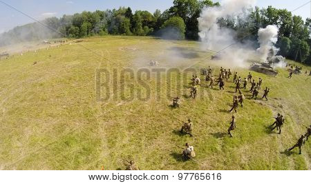RUSSIA, NELIDOVO - JUL 12, 2014: Assault of Soviet soldiers with tanks during reconstruction Battlefield at Second World war. Aerial view. (Photo with noise from action camera)